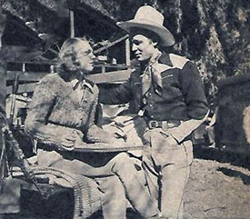 "Roy Rogers and Linda Hayes chat during lunch break on location for ""South of  Santa Fe"" ('42 Republic)."