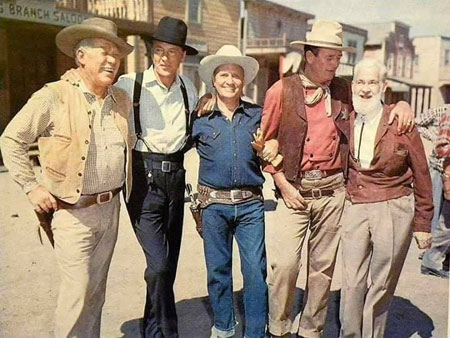 "A quintet of Western stars on the set of TV's ""Wide Wide World: Westerns"" which aired on June 8, 1958. Ward Bond, Gary Cooper, Gene Autry, John Wayne,  Gabby Hayes."
