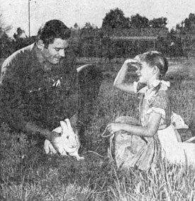 "6'6"";, 235 lb. Clint Walker helps daughter Valerie Jean with her pet rabbit."
