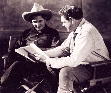Bob Steele and his father, director Robert Bradbury, look over a script for one of Bob's early B-westerns.