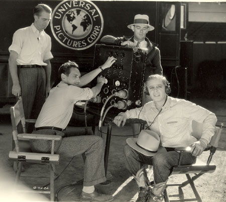 Two behind the scenes pics of Hoot Gibson as he checks out the sound recording on his early 1929 Universal sound westerns.