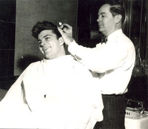 He had the most gorgeous head of hair in westerns! Dale Robertson gets a trim in Jackson, MS, during a personal appearance there. (Photo courtesy Danny Brown.)
