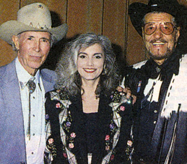 Eddie Dean, country singer Emmylou Harris and Herb Jeffries at an Autry Museum tribute to the singing cowboys in 1992.