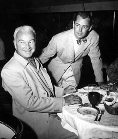 "Alan Ladd stops to chat with William ""Hopalong Cassidy"" Boyd. Best guess is the photo was taken in the mid '50s."