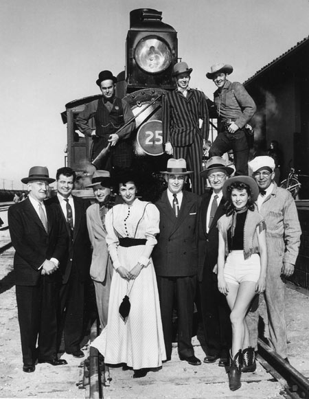 "Actress Jan Shepard (in shorts) represented Union Pacific Railroad as Miss Union Pacific for two years, circa '52-'54. She did all advertising for Union Pacific during that time. Her husband-to-be, Dick London is standing on top of the train, to the right. London played Morgan Earp on Hugh O'Brian's ""Wyatt Earp"" TV series."
