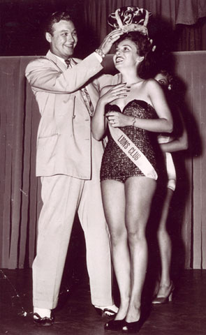 Monte Hales presides over a beauty contest in Odessa, TX, in 1948. The girl, Enid Holm, won the Miss West Texas title and was later a runner up for the Miss Texas title.