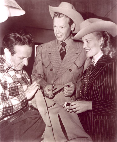 Rex Allen and his wife Bonnie check out a new Nudie suit at Nudie's N. Hollywood tailor shop.