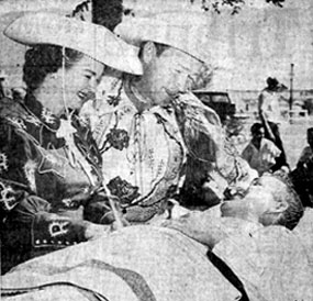 Newspaper photo of Roy Rogers and Dale Evans, starring at the New Mexico State Fair in October, 1957. Visiting local hospitals, here they talk with Rex Richards who recalled meeting Roy back in 1947.