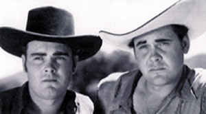 Sunset Carson (R) and his brother Dale who appeared with Sunset in several of Sunset's lowbudget Yucca Pictures in 1948.