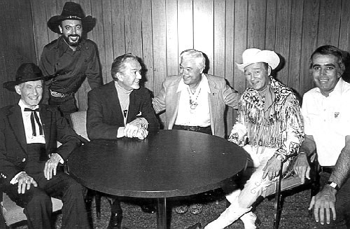 "(L-R) Tim McCoy, music producer and former owner of Nostalgia Merchant Snuff Garrett, Kirk Alyn, Monte Hale, Roy Rogers and Tom Snyder backstage during the taping of Snyder's late night ""Tomorrow"" talk show on NBC on November 28, 1977."