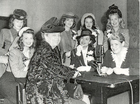 "1946 photo of Eleanor Roosevelt with the Goldwyn Girls during a publicity tour for the movie ""The Kid From Brooklyn"". B-western actress Virginia Belmont is in the back center, hat on, directly behind Mrs. Roosevelt. The only other ID'd girl is Shirley Ballard at the bottom left. Can anyone ID any of the other ladies? Belmont co-starred in B-westerns with Johnny Mack Brown, Jimmy Wakely, Hopalong Cassidy and in the serial ""Dangers of the Canadian Mounted"" ('48)."