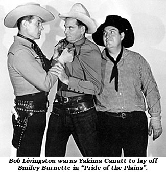 "Bob Livingston warns Yakima Canutt to lay off Smiley Burnette in ""Pride of the Plains""."