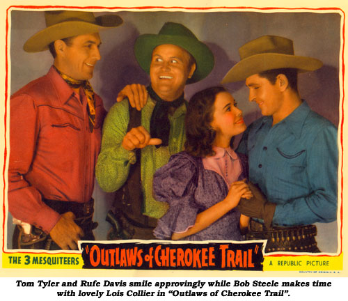 "Tom Tyler and Rufe Davis smile approvingly while Bob Steele makes time with lovely Lois Collier in ""Outlaws of Cherokee Trail""."