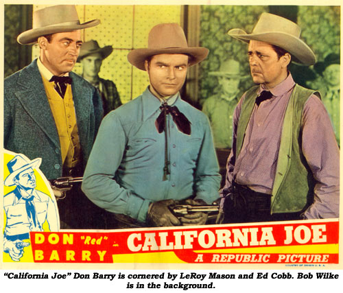 """California Joe"" Don Barry is cornered by LeRoy Mason and Ed Cobb. Bob Wilke is in the background."