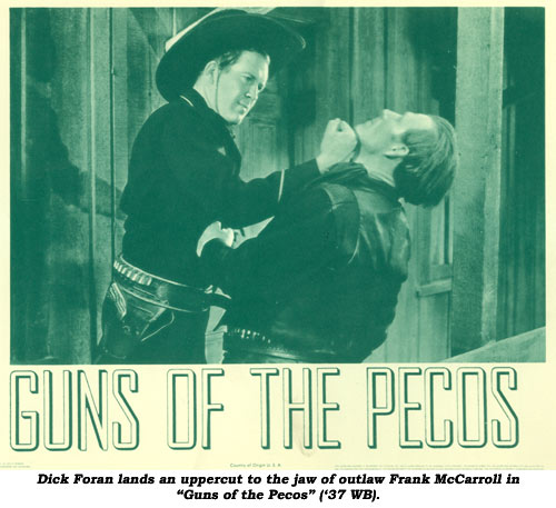 "Dick Foran lands an uppercut to the jaw of outlaw Frank McCarroll in ""Guns of the Pecos"" ('37 WB)."