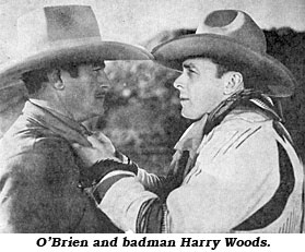 "O'Brien with badman Harry Woods in ""When a Man's a Man""."