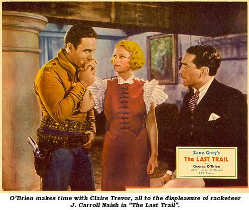 "O'Brien makes time with Claire Trevor, all to the displeasure of racketeer J. Carroll Naish in ""The Last Trail""."