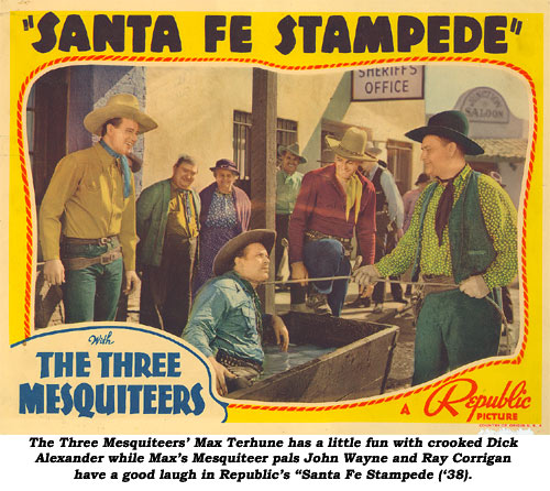 "The three Mesquiteers' Max Terhune has a little fun with crooked Dick Alexander while Max's Mesquiteer pals John Wayne and Ray Corrigan have a good laugh in Republic's ""Santa Fe Stampede"" ('38)."