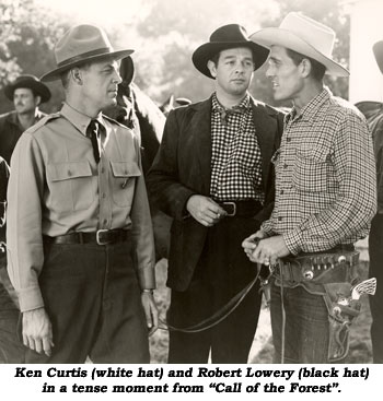 "Ken Curtis (white hat) and Robert Lowery (black hat) in a tense moment from ""Call of the Forest""."