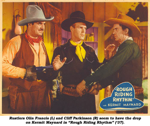 "Rustlers Olin Francis (L) and Cliff Parkinson (R) seem to have the drop on Kermit Maynard in ""Rough Riding Rhythm"" ('37)."