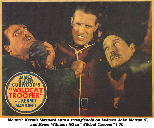 "Mountie Kermit Maynard puts a stranglehold on badmen John Merton (L) and Roger Williams (R) in ""Wildcat Trooper"" ('36)."