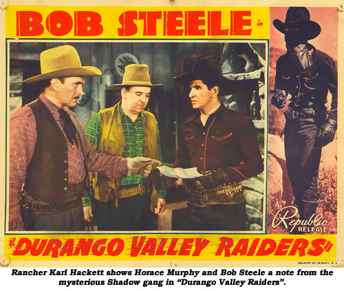 "Rancher Karl Hackett shows Horace Murphy and Bob Steele a note from the mysterious Shadow gang in ""Durango Valley Raiders""."