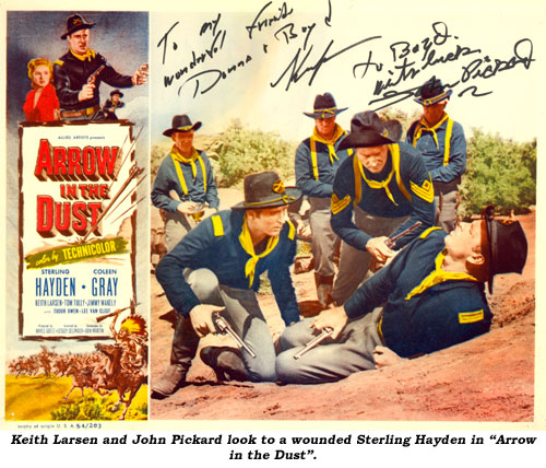 "Keith Larsen and John Pickard look to a wounded Sterling Hayden in ""Arrow in the Dust""."