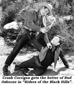 "Crash Corrigan gets the better of Bud Osborne in ""Riders of the Black Hills""."