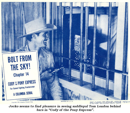 "Jocko seems to find pleasure in seeing saddlepal Tom London behind bars in ""Cody of the Pony Express lobby card from Chapter 14."