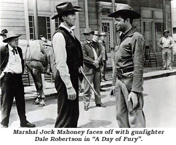 "Marshal Jock Mahoney faces off with gunfighter Dale Robertson in ""A Day of Fury""."
