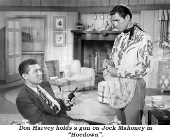 "Don Harvey holds a gun on Jock Mahoney in ""Hoedown""."