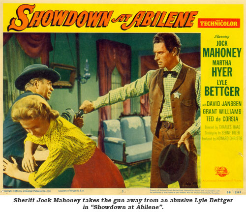 "Sheriff Jock Mahoney takes the gun away from an abusive Lyle Bettger in ""Showdown at Abilene""."